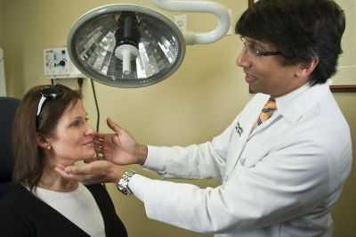 Dr. Prasad examining patient for eye bags